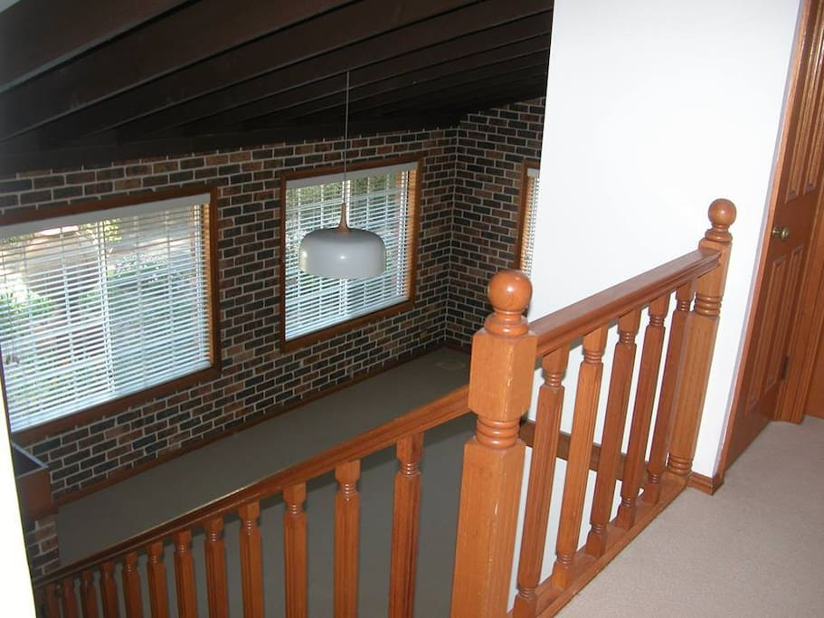 Living area of 4 split level townhouse. 4 rooms available: the triple bunker, double , double w'ensuite, or the single room