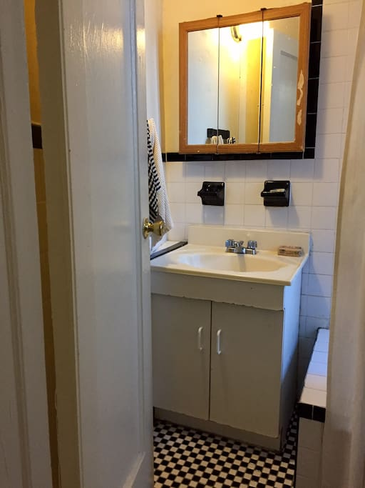 The bathroom is very quaint with original black and white tiles.