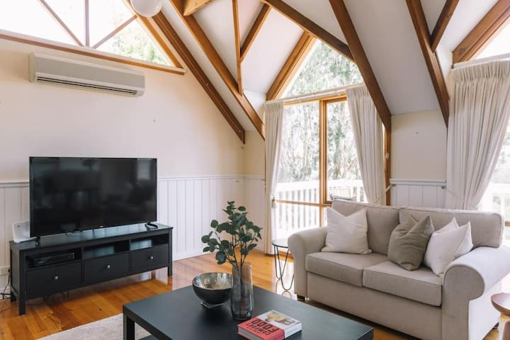 Upper Lounge - under gable windows, aircon, flat screen TV, three lounge suites