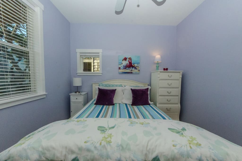 Cozy coastal colors and furnishings in Queen bedroom.