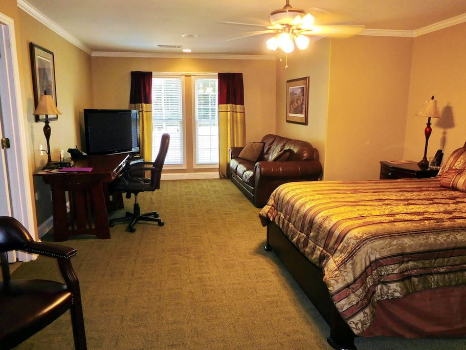 Quiet Room in Midland includes a queen size bed, sitting area with 50 inch Flat Screen TV, desk and WiFi