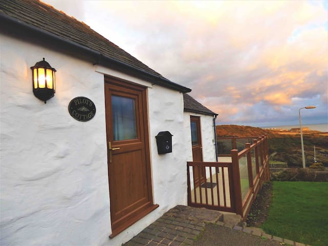 Pilot's Cottage, with stunning sea views.