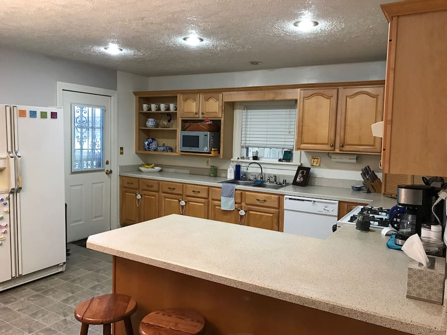 Enjoy our fully equipped kitchen with both a full size table in an open eating area along with countertop seating. (Eating space for up to 10.)