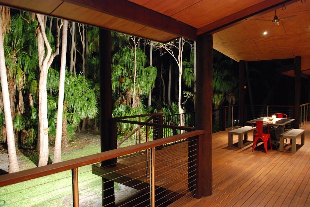 relax in the evening on the deck looking out onto the floodlit palm forest