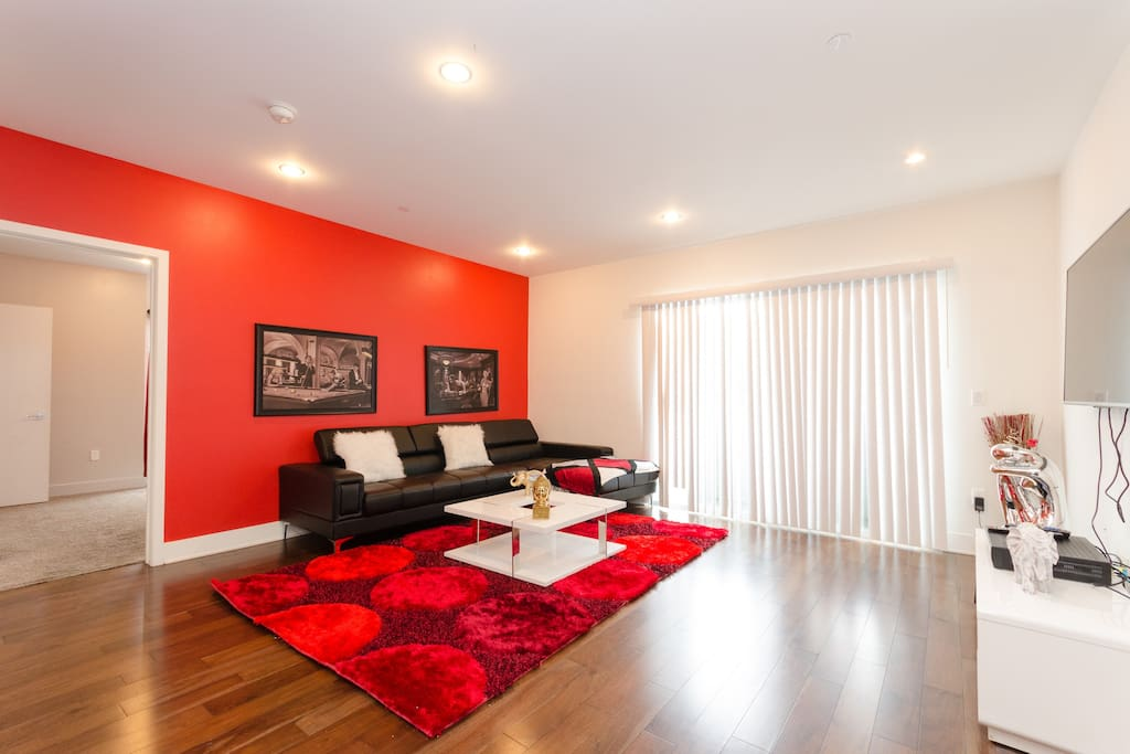 Italian leather sectional and HD TV in living room