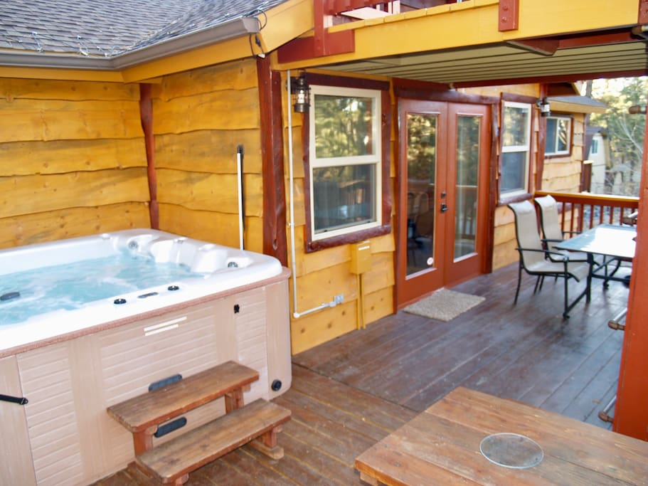The deck has a 5 person spa, a natural gas grill, and seating for 10.