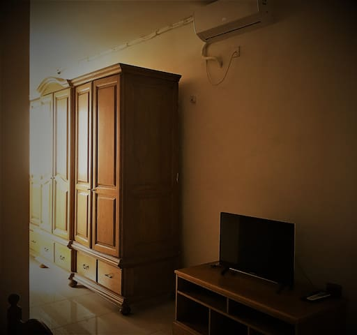 Flat screen & Fully air conditioned room. Large Wardrobe.