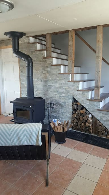 Cozy up by the wood stove - lots of games in the cupboards.