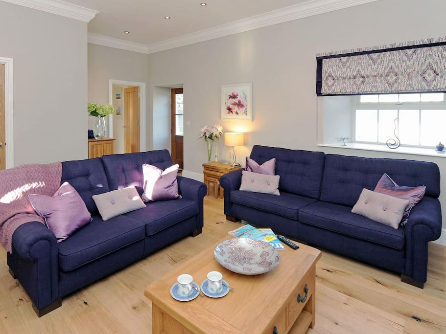 Comfy seating area in the living room | The Tower, Dreenhill, near Haverfordwest