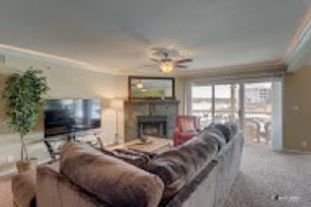 "Family room with fireplace, 60"" Smart TV, large sectional can sleep 2."