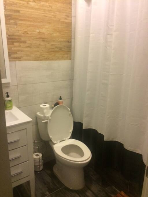 Full bathroom directly outside of available bedroom.