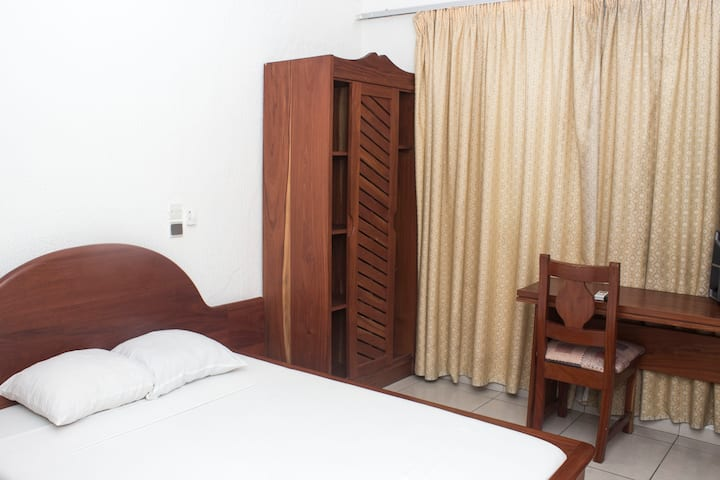 Chambre Double à L'Hôtel Résidence les Cocotiers