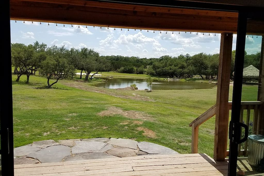 View from the living room. Put your feet up and enjoy the beauty; cranes, purple martins, cardinals, fish eagles, and whispering ducks are often spotted visiting the pond.