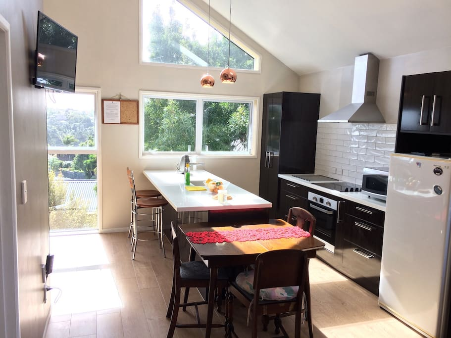 Enjoy full kitchen with all major appliances and island bench with washing machine / dryer.