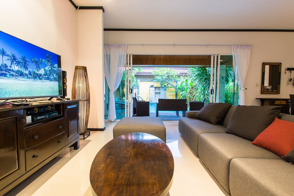 Open Living Room with Longer Sofa & Satellite TV over 200 TV and Radio Channels in all Different Languages with Pool and Garden View.