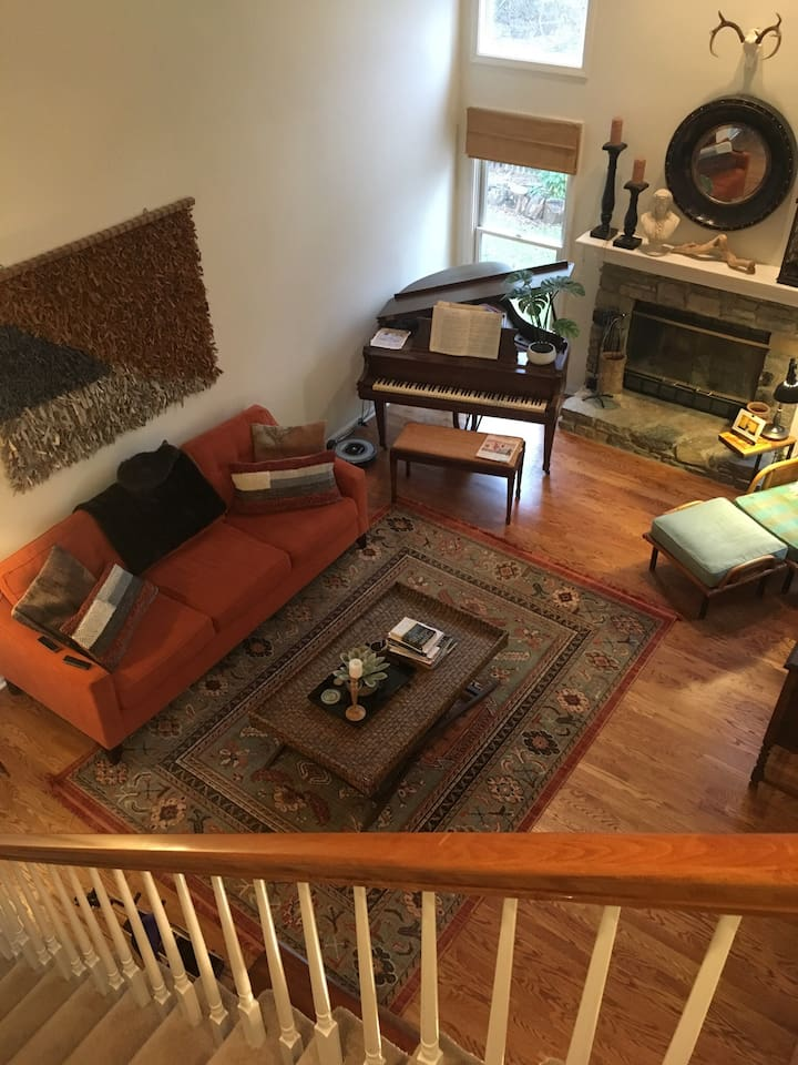 Open and airy living room located adjacent to kitchen, breakfast area, dining, and foyer.
