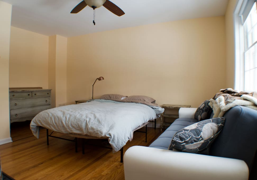 Bedroom 1.  Queen sized bed and futon.  Futon folds out to a single bed.  Master bathroom is attached to this room.