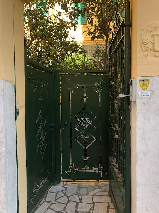 the entrance in your magic roma garden house between  a lemon tree