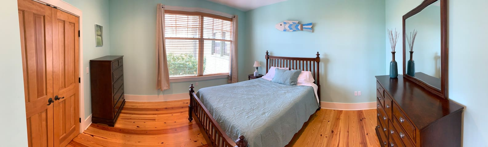 This guest room has 1 queen bed and features a large window overlooking the water.