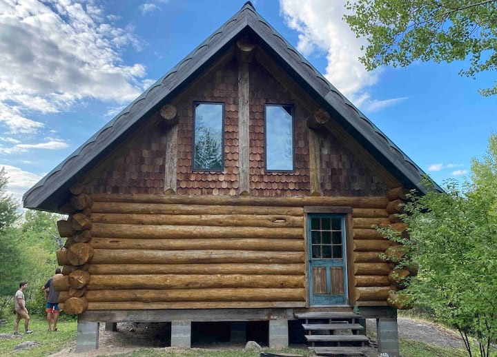 Beautiful hand built log cabin on 40 wooded acres