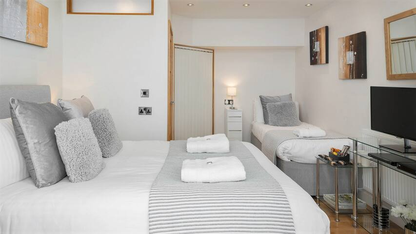 SECOND BEDROOM with King Size and Single Bed