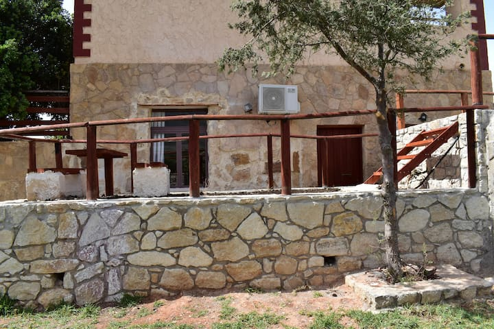 Ground floor Irida Cottage & shared swimming pool