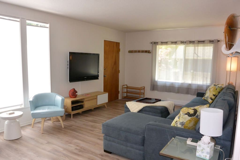 Cozy living room with sectional sofa, Flat Screen TV, DVD player, and more