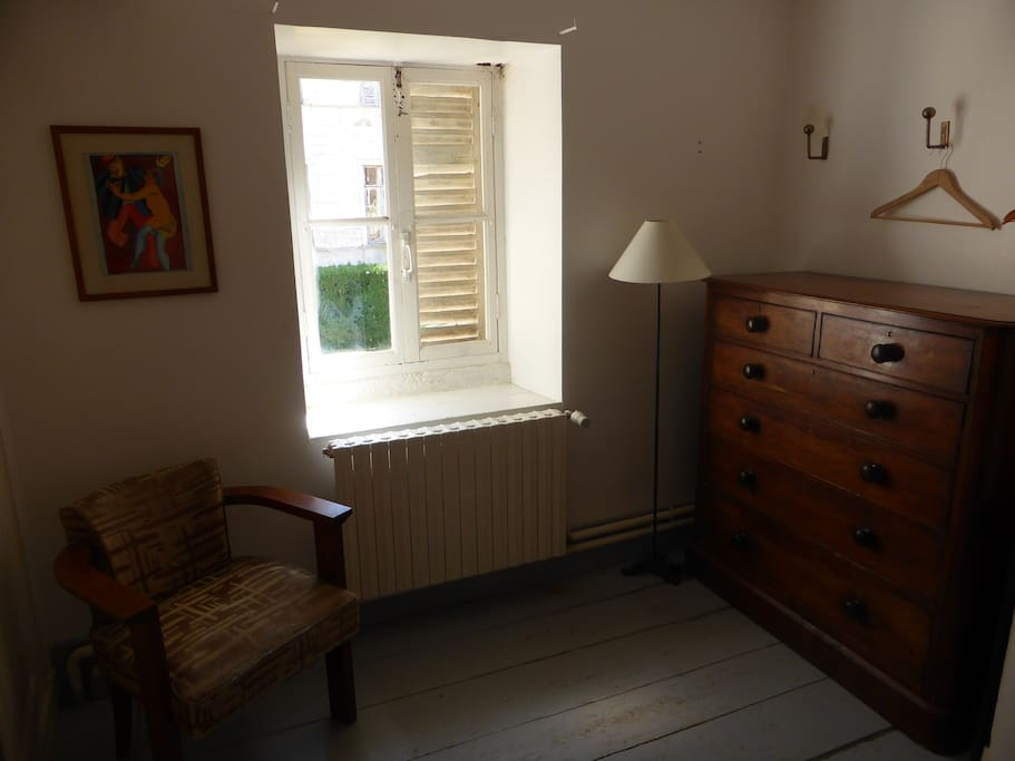 The Redroom has a cupboard and a chest of drawers
