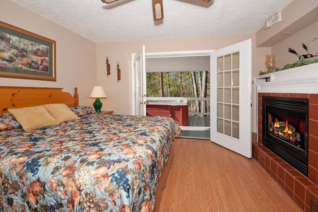 Main Floor Bedroom with access to Hot Tub