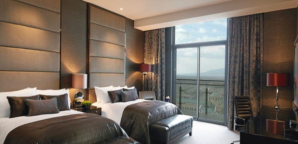 Bedroom 3 featuring 2 queen size beds, a desk area for your laptop or extra workspace. HDTV for bedside entertainment and a giant window for an amazing view of the city.