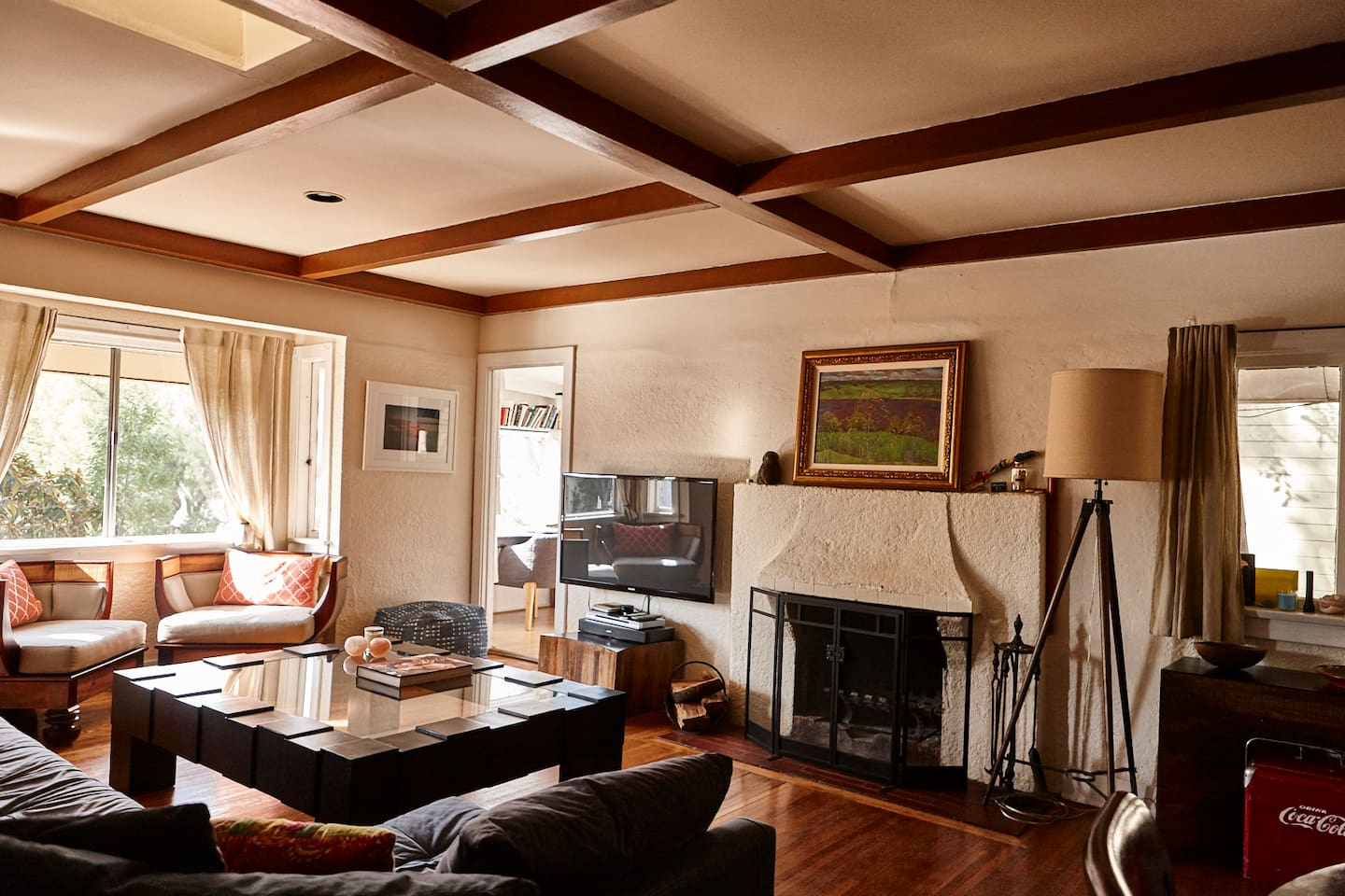 Large living room space with working fireplace and adjustable flatscreen.  Above street level with views over the canyon.