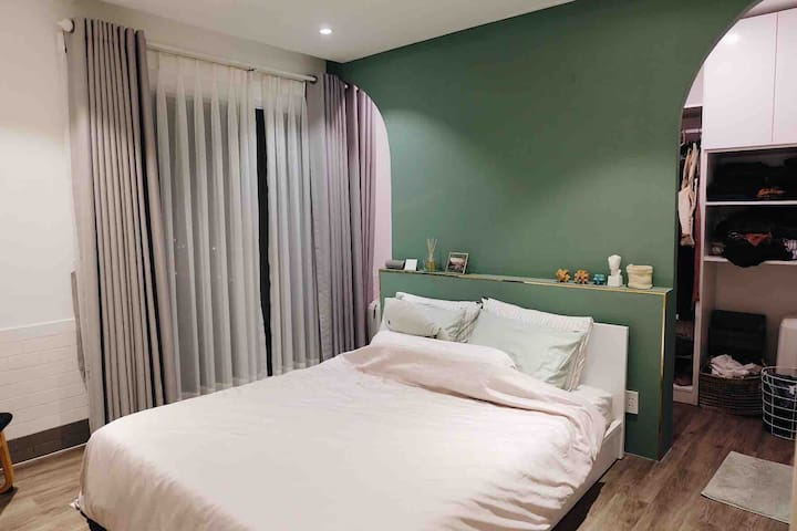 The suite bedroom with walking closet, private toilet and makeup table.  We provide a fan, an air condition, hair dryer, iron.