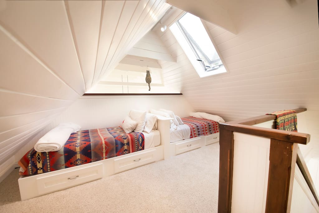 The loft has two cozy twin beds.