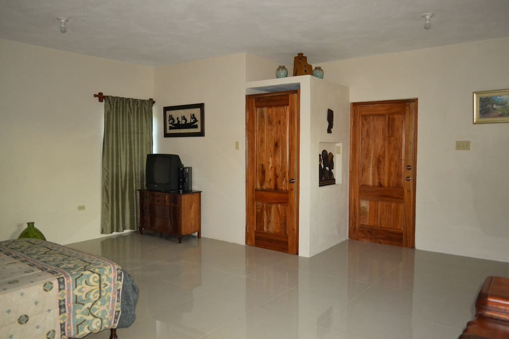 Sunny Hill View Villa and Conference Center. Suite 1 (fully self contained). Separate entrance, bathroom, living area, fridge and microwave.  Fits 2 comfortably. Blow up bed can be provided for additional persons.