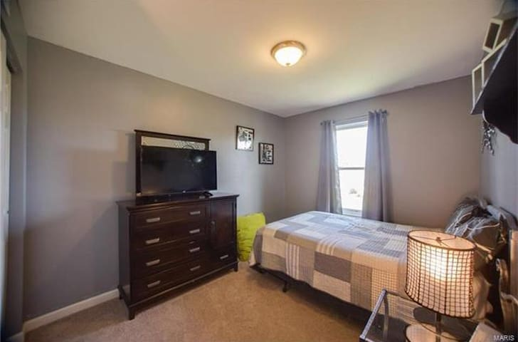 Third guest room, there is full size bed and another flat screen tv
