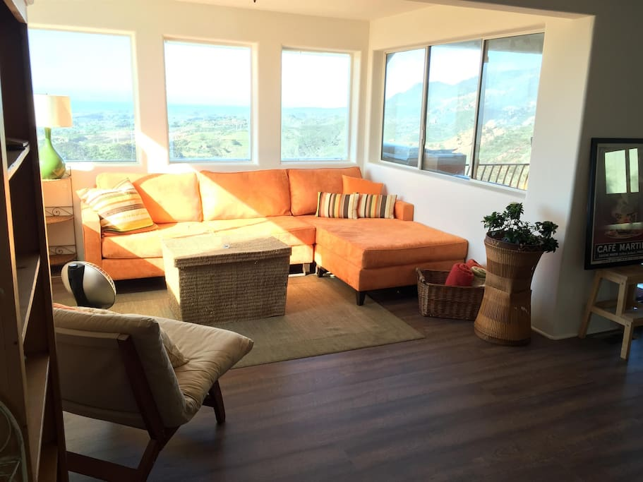 Sunny, bright living room with gorgeous views as far as the eye can see.
