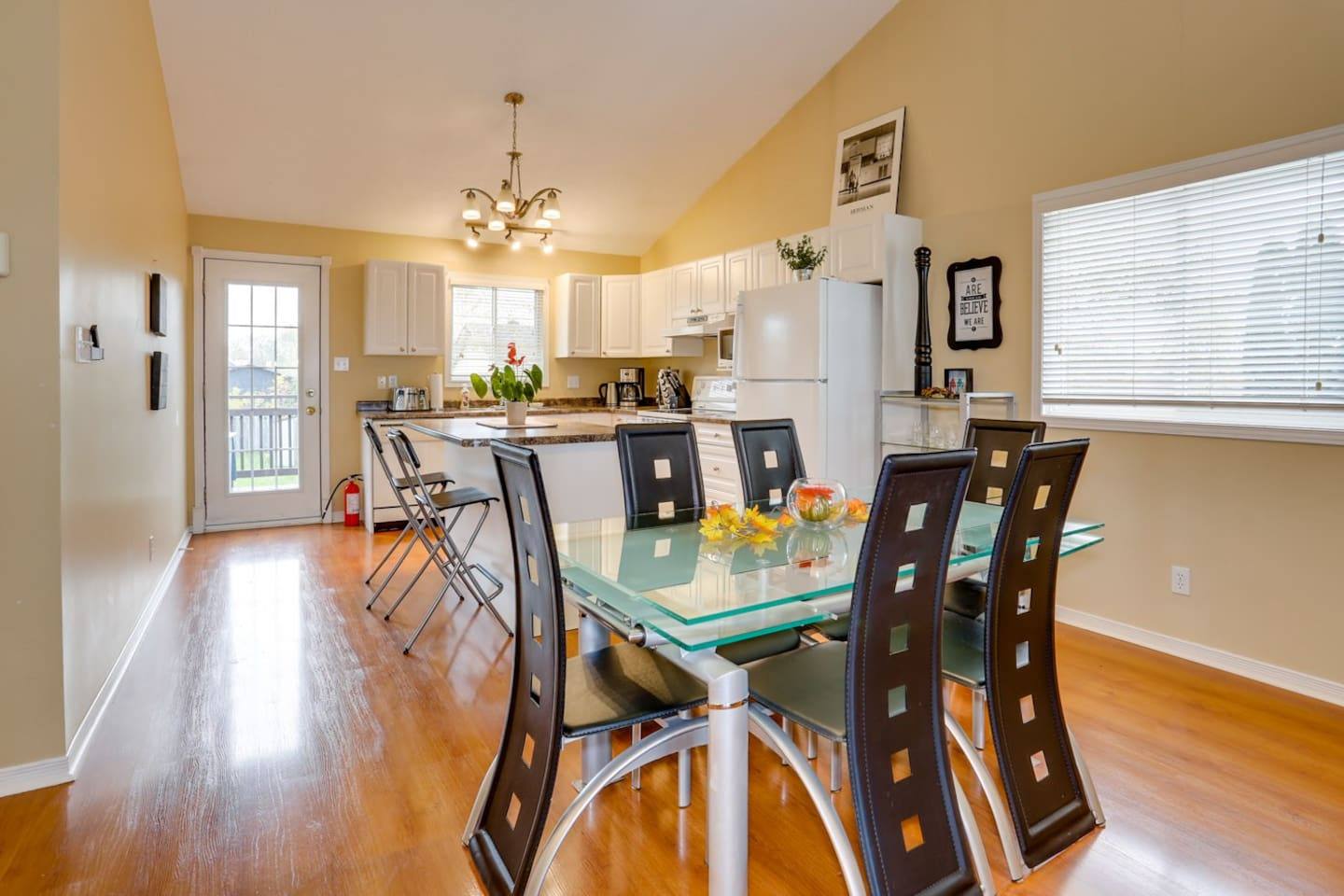 Open concept kitchen & dining area has lots of natural light