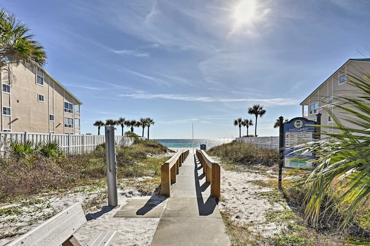 You won't miss a beach day with the sand just 100 yards from your door!