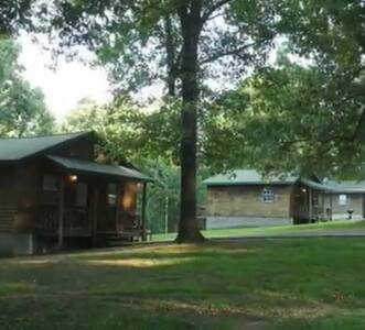 "Little Cedar Cabins/""Country Quiet, City Close."""