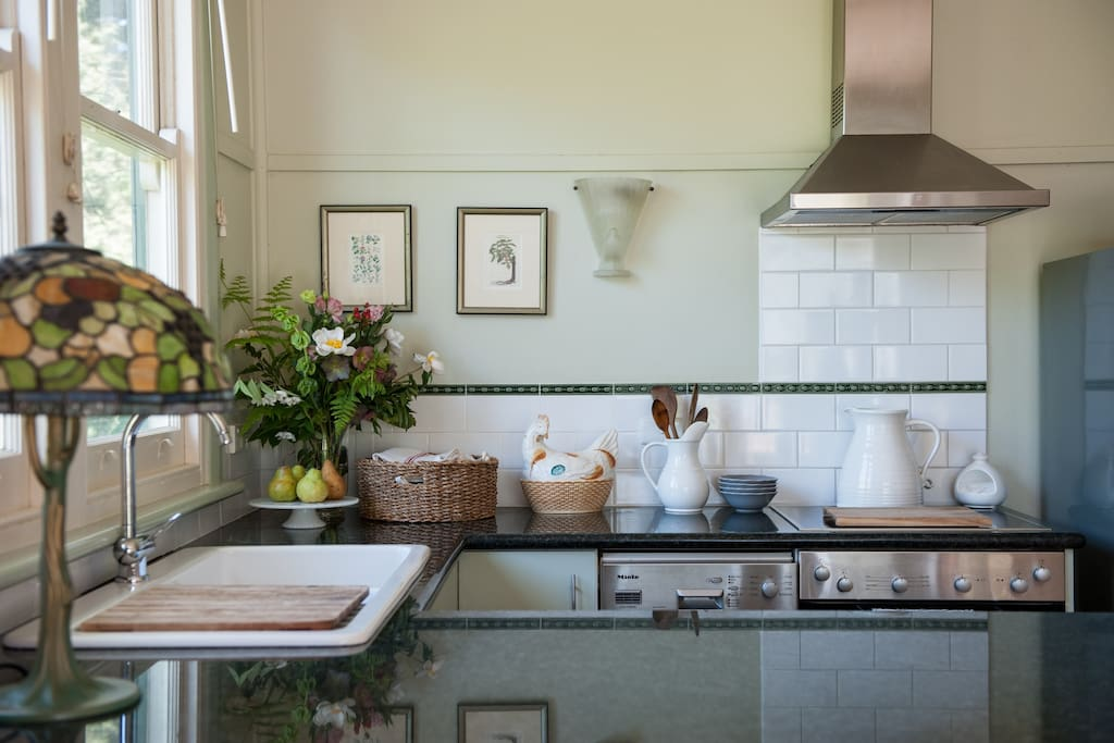 Full kitchen. Miele appliances, porcelain sink and lots of cooking utensils.