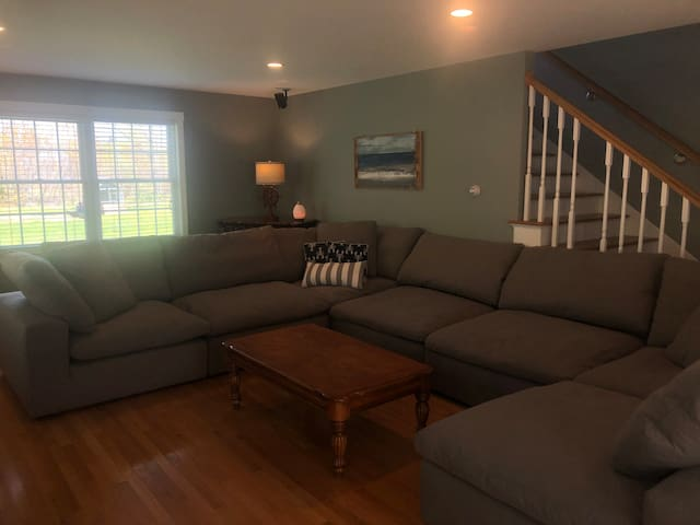 Living room with couch that can seat 10-12 people.