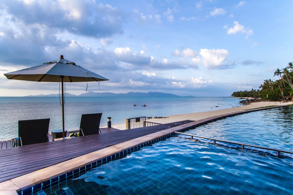The guest pool with children's area overlooking the beautiful beach. Koh Phangan island can be seen in the distance