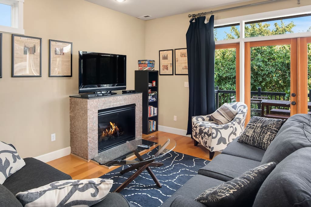 Gather around the tv and fireplace for some family fun after a day of touring Seattle