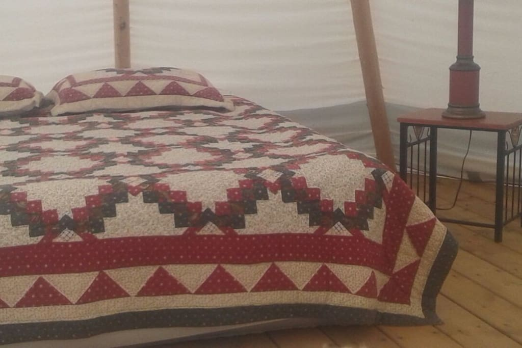 Inside look of the Tipi, with a Queen size bed