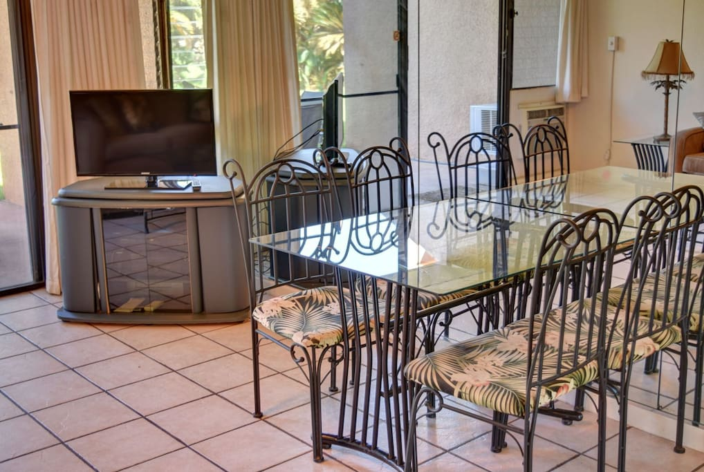Flat screen tv and dining area with seating for 4