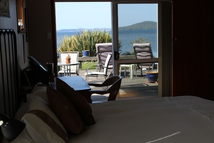 Tui Room Opens onto lakeside deck.