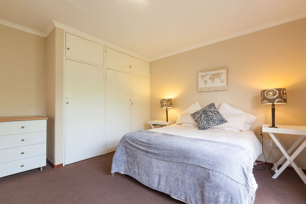 Spacious bedroom with queen size bed and lots of packing space