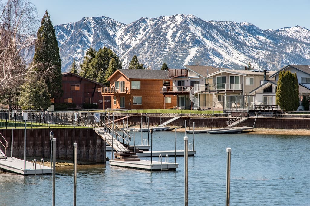 Majestic mountains rise over your private boat dock.