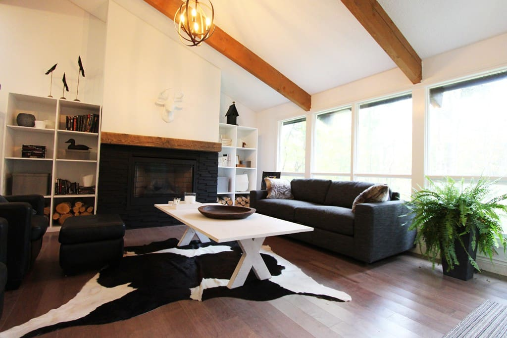 The bright living room with gas fireplace.