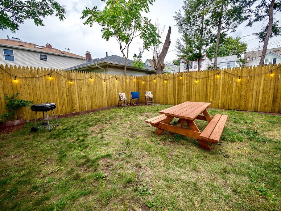 Enjoy our large backyard common space with fairy lights and picnic table.
